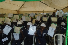 Defensively trained drivers display their certificates