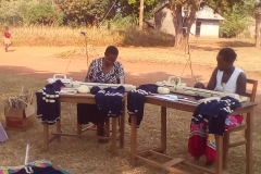Members trained by BWU busy knitting sweaters